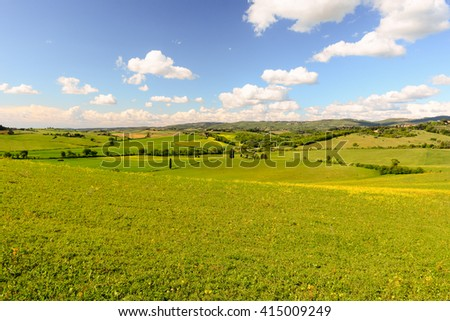Typical tuscan landscape in spring with hills - stock photo