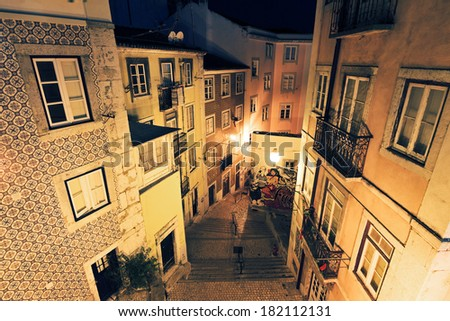 Typical urban scene in the narrow streets of Lisbon, Portugal, at night - stock photo