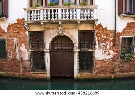 Typical Venice residential house architecture detail. Ramshackle door. Italy