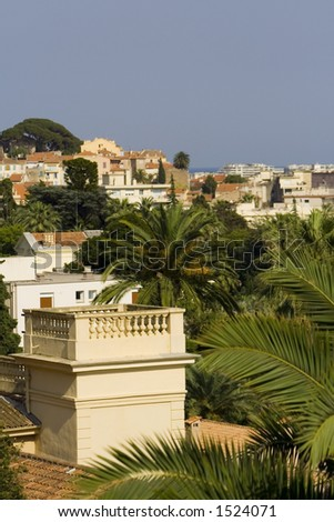Typical view of the city of Cannes, French Riviera, Cote d'azure: luxurious villas with palm trees near the sea - stock photo