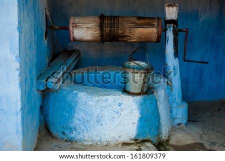 Typical water well in moldovian village, Moldova - stock photo