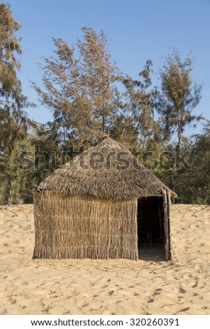 Typical West-African hut with a straw roof - stock photo
