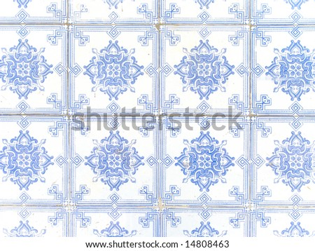 Typical white and blue portuguese ceramic tiles called Azulejos - stock photo