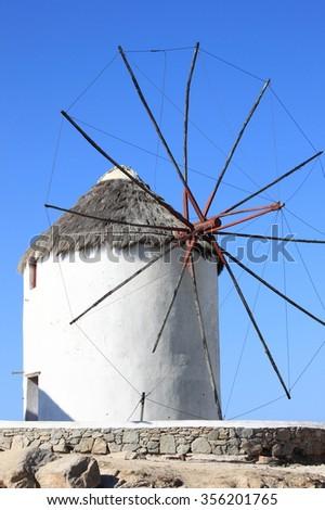 Typical windmill on a hillside near the sea in Mykonos Island, Greece - stock photo
