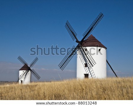 Typical windmills in the area of La Mancha, in Spain, which have become famous thanks to the book Don Quixote de la Mancha by Miguel de Cervantes - stock photo