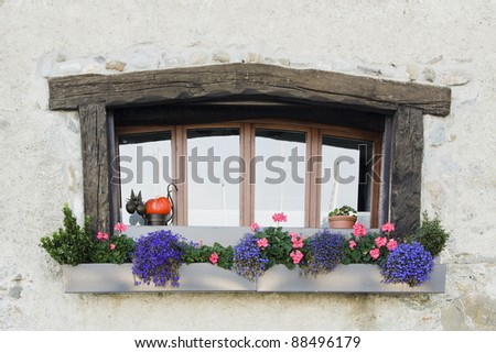 typical window of a house in Yvoire Haute-Savoie, France