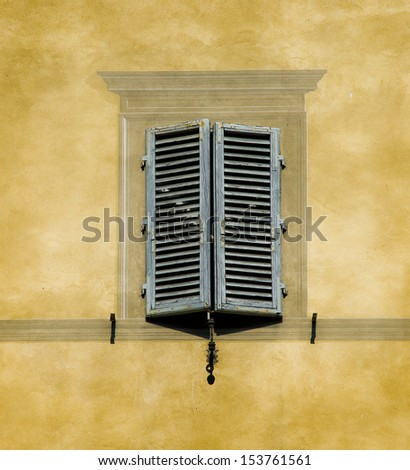 Typical window of Tuscan architecture in monumental building. Siena, Italy - stock photo