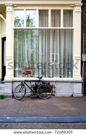Typical window with parked bike in Amsterdam, The Netherlands. - stock photo
