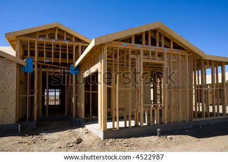 Typical wood frame construction in new housing development - stock photo