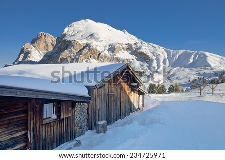 Typical wooden chalet in the Dolomites mountain in winter, South Tyrol, Italy - stock photo