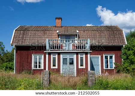 Typical wooden cottage (abandoned) in the countryside near Pelarne, Sweden - stock photo