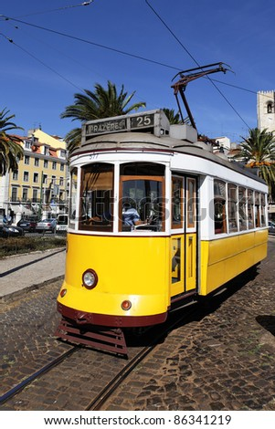 Typical yellow Tram in Lisbon street, Portugal - stock photo