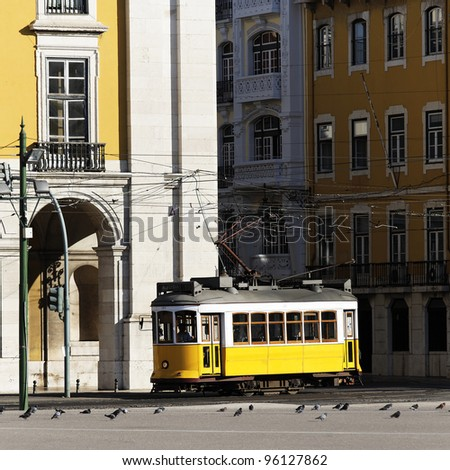 Typical yellow Tram in old street, Lisbon, Portugal - stock photo