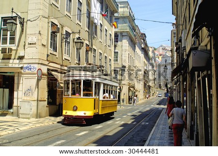 Typical yellow tram on the street in Lisbon, Portugal - stock photo