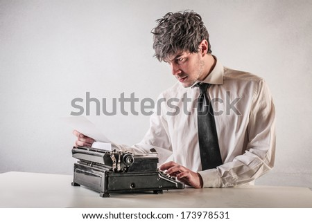 typing businessman - stock photo