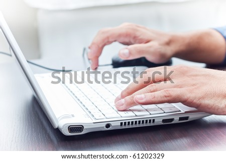 typing on a white notebook - stock photo