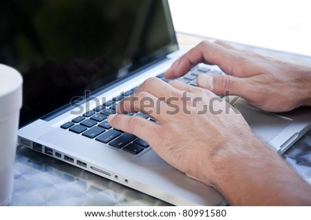 Typing on computer - stock photo