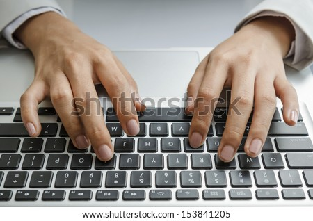 Typing on keyboard - stock photo