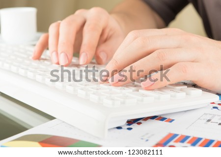 Typing on keyboard. Woman hands, close view - stock photo
