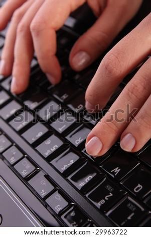 Typing on laptop - stock photo