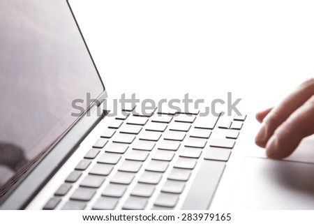 typing on the laptop ,office space ,office background  - stock photo