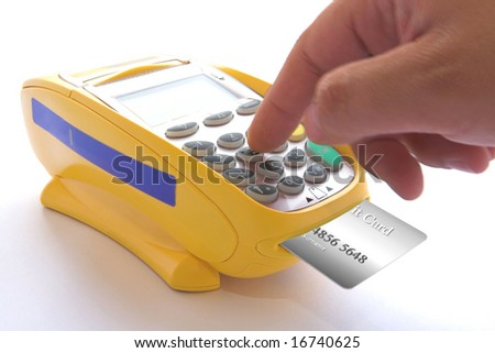 Typing the amount of the sale to pass a credit card with chip, through the POS - stock photo