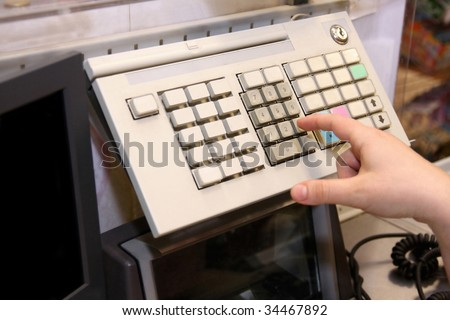 Typing to the cashier at the supermarket - stock photo