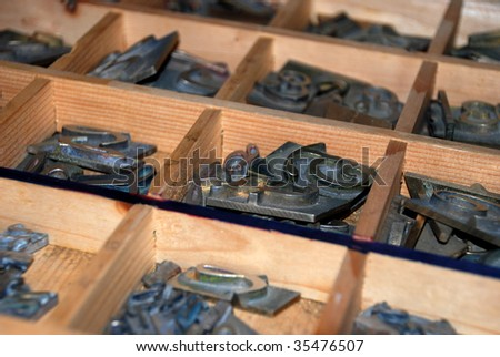 Typography workshop: old lead type for printing - stock photo