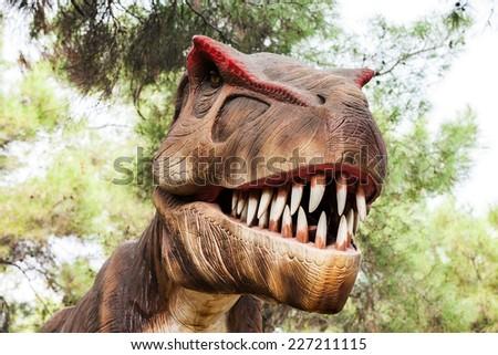 Tyrannosaurus - prehistoric era dinosaur showing his toothy mouth - stock photo
