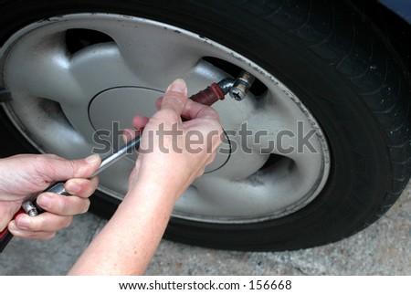 Tyre pressure checking - stock photo