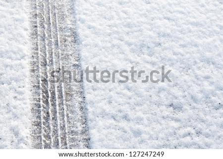 tyre tracks imprinted into fresh snow a great background for rallies or four wheel drive cars - stock photo
