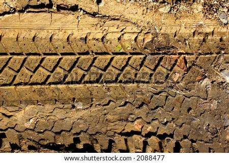 tyre tread pattern in mud - stock photo