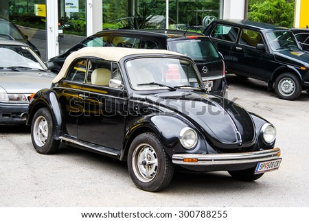 TYROL, AUSTRIA - JULY 29, 2014: Black retro car Volkswagen Beetle at the used cars trade center. - stock photo