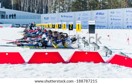 "Tyumen,RUSSIA - APR 9,2014:Martin Fourcade (FRA) and other on a firing line at Biathlon  Men's Mega Mass start at International Biathlon Competition ""Award from the Governor of the Tyumen region - stock photo"