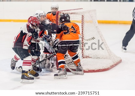 Tyumen, Russia - April 14, 2013: Hockey tournament on prize of name A.P.Vahrin among teams of children till 9 years old. Game between the Spartakovetc 04 (Ekaterinburg) and Molot 04 (Perm) - stock photo
