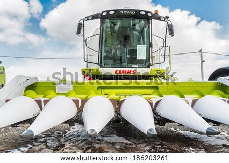 """Tyumen, Russia - April 04. 2014: IV Tyumen specialized exhibition """"Agricultural Machinery and Equipment"""". Corn harvester demonstration - stock photo"""