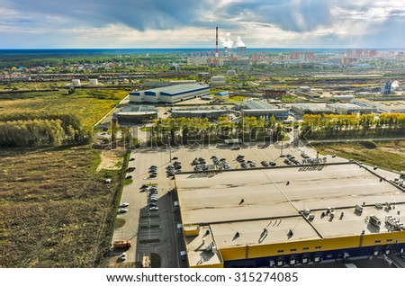 Tyumen, Russia - August 25, 2015: Aerial view on Group of car shops so called autograd and Lenta hypermarket. On background Voynovka railway station with residential district - stock photo