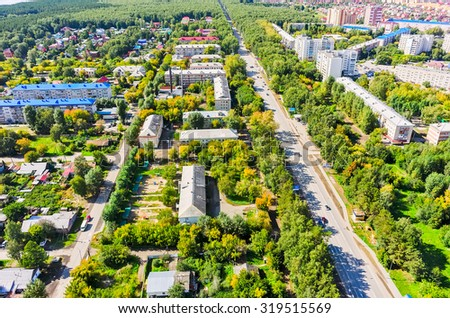Tyumen, Russia - August 27, 2015: Aerial view on sleeping neighborhood in Mys complex with old houses - stock photo