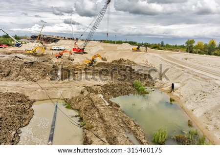 Tyumen, Russia - August 29, 2015: East Round road and bridge construction. Transition through the Tura River - stock photo