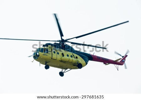 Tyumen, Russia - August 11, 2012: On a visit at UTair airshow in Plehanovo heliport. Passenger helicopter MI-8 Flying