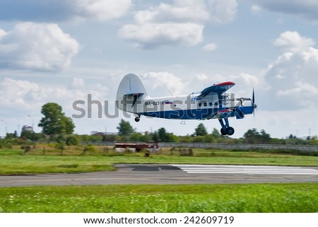 Tyumen, Russia - August 16, 2014: On visit at UTair airshow in Plehanovo heliport. Antonov AN-2 airplane of Utair Cargo company demonstrates flying opportunities - stock photo