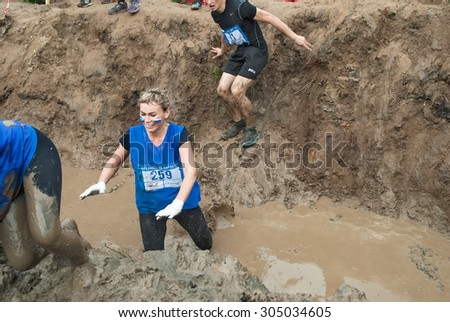 Tyumen, Russia - August 8, 2015: Steel Character extrim race on Krugloe lake. Gagarin park in Cape district. Obstacle - Mud hole. Selection stage - stock photo