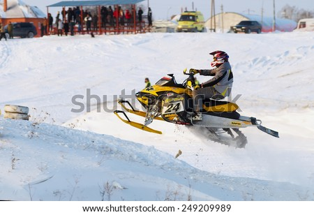 Tyumen, Russia - December 26. 2009: Sport snowmobile racing on championship of Ural region. Sportsman on snowmobile on track