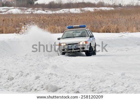 "Tyumen, Russia - February 22, 2015: Ice autodrome ""Ice cult"" on Alebashevo lake. Competitions for police officers ""Special operation ""Ice"" - stock photo"