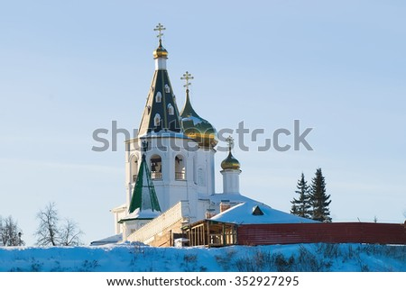 Tyumen, Russia - January 23, 2010: Holy Trinity Monastery. Church of Saints Peter and Paul and Holy Trinity Cathedral - stock photo