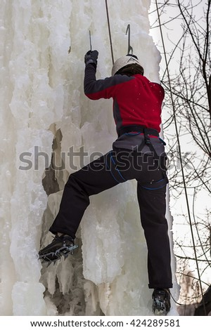 Tyumen, Russia - January 19, 2008: Tower which is filled in with water near Children Club of Kizhevatov name. Ice climbing competition. Man climbs upward - stock photo