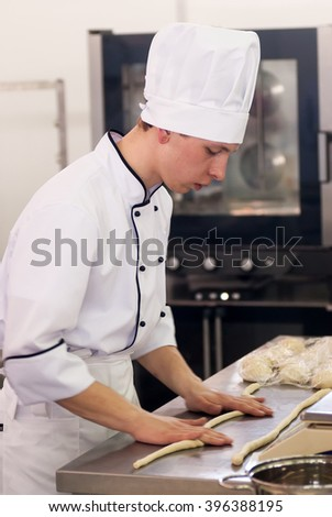 Tyumen, Russia - March 23. 2016: Open championship of professional skill among youth. World skills Russia Tyumen - 2016. Young cook prepares food in competition of masters of cook business - stock photo