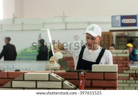 Tyumen, Russia - March 24, 2016: Open championship of professional skill among youth. World skills Russia Tyumen - 2016. Young bricklayer performs a task of competition of professionals - stock photo
