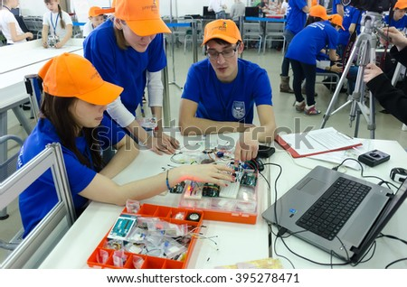 Tyumen, Russia - March 23. 2016: Open championship of professional skill among youth. Worlld skills Russia Tyumen - 2016. Students of the Tyumen teacher training college show electronic components - stock photo