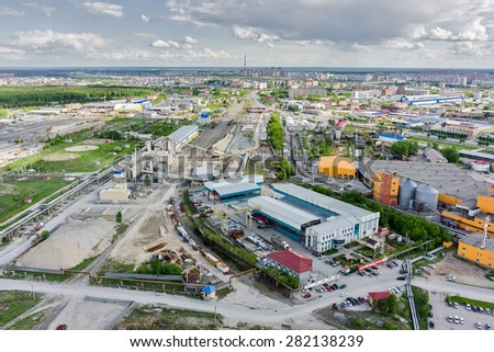 Tyumen, Russia - May 19, 2015: Aerial view onto railway industrial cargo transportation company (Promzheldortrans) and ARS-Prom steel product company - stock photo